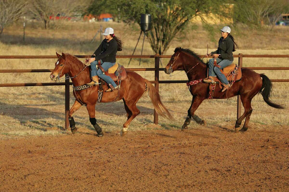 Jackie, right, and Emely Ayala practice in the arena built by their father. Eventually, the complex will host full charreadas and seat up to 300.