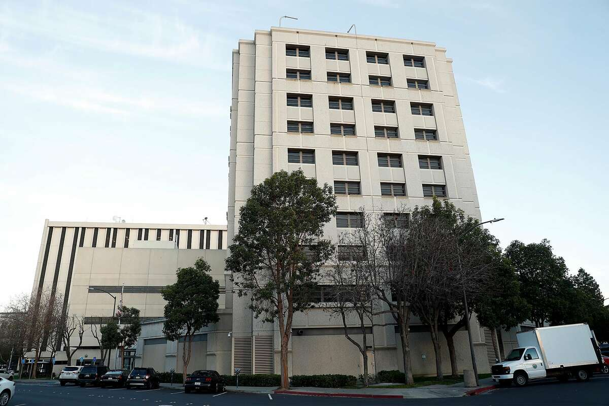 An inspector from the San Mateo County District Attorney's Office uncovered an unemployment benefits scam while listening to a call from the county jail.