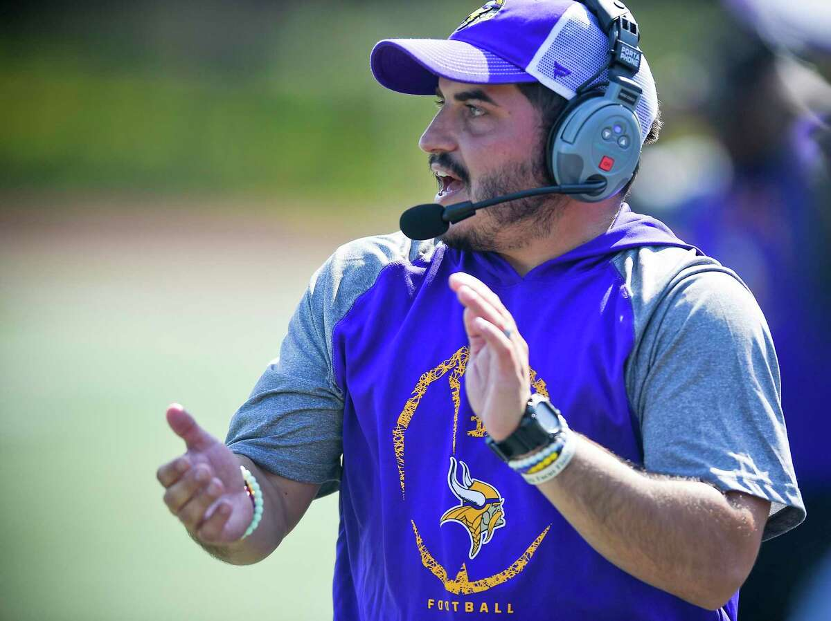 Westhill coach Joey DeVellis shouts encouragement to his players in an FCIAC football game against Darien at Westhill High School's J. Walter Kennedy Stadium on Sept. 28, 2019 in Stamford, Connecticut.