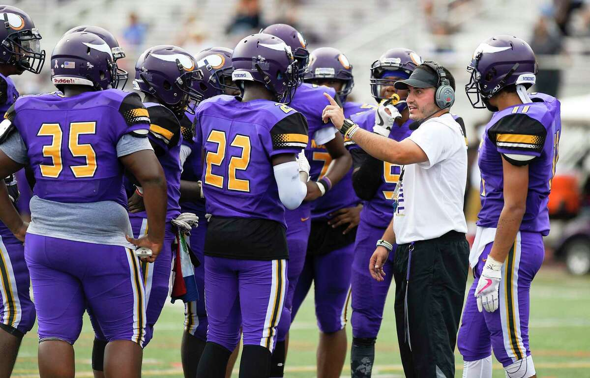 In his first year as Head coach, Westhill's Joe DeVellis talks with his players in a FCIAC football game against Norwalk on Saturday, Sept. 15, 2018 in Stamford, Connecticut. Norwalk defeated Westhill 48-21 in the Vikings home opener at J.Walter Kennedy Stadium.
