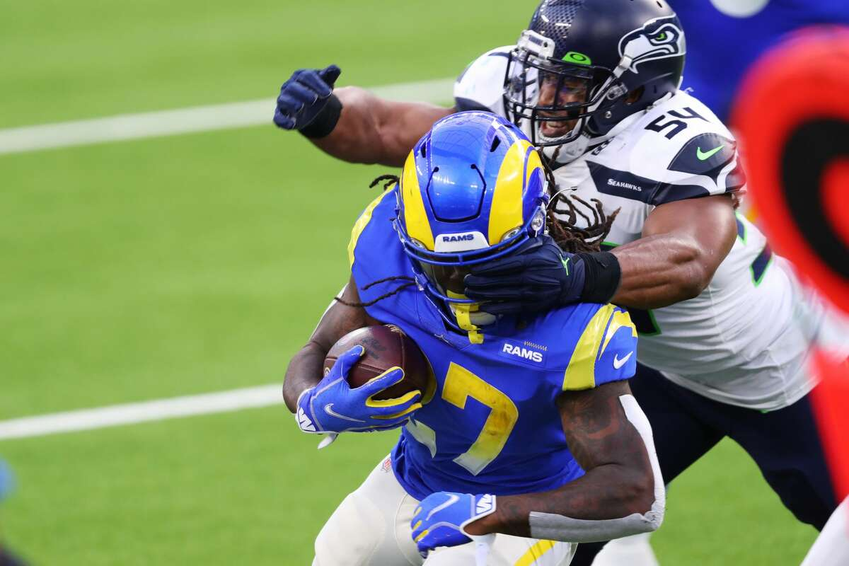 INGLEWOOD, CALIFORNIA - NOVEMBER 15: Darrell Henderson #27 of the Los Angeles Rams is tackled by Bobby Wagner #54 of the Seattle Seahawks at SoFi Stadium on November 15, 2020 in Inglewood, California. (Photo by Joe Scarnici/Getty Images)