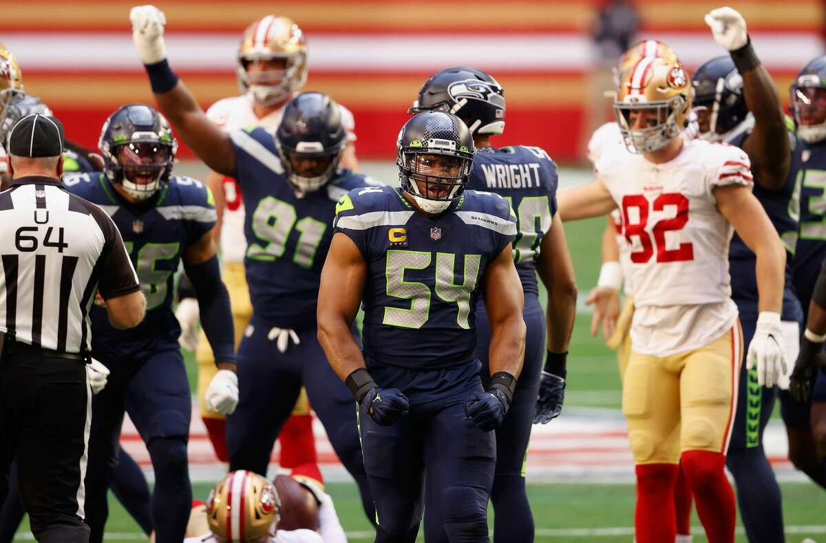 GLENDALE, ARIZONA - JANUARY 03: Middle linebacker Bobby Wagner #54 of the Seattle Seahawks reacts to a sack on quarterback C.J. Beathard #3 of the San Francisco 49ers during the first half of the NFL game at State Farm Stadium on January 03, 2021 in Glendale, Arizona. The Seahawks defeated the 49ers 26-23. (Photo by Christian Petersen/Getty Images)