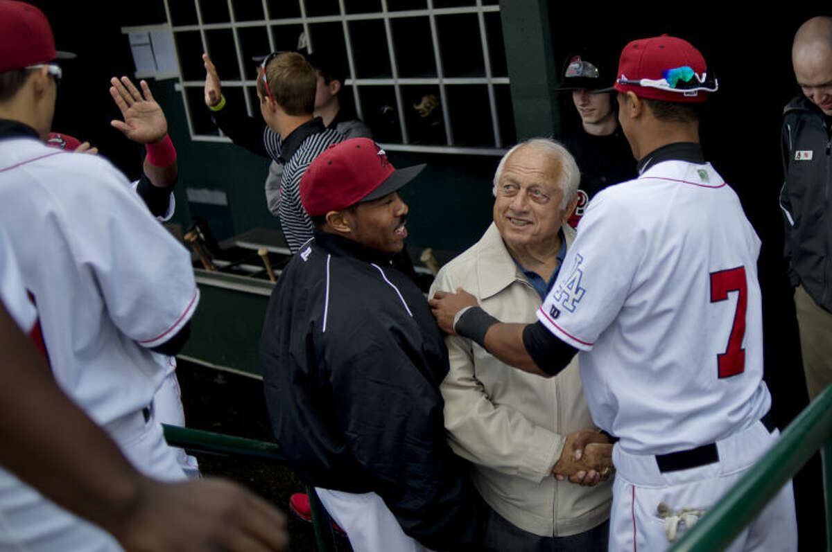 Tommy Lasorda visits the Great Lakes Loons in their dugout prior to the start of the team's home opener against Cedar Rapids on April 8, 2014.