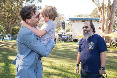 Justin Townes Earle with his father, Steve Earle, and his half-brother John Henry Earle at Hardly Strictly Bluegrass in 2017.