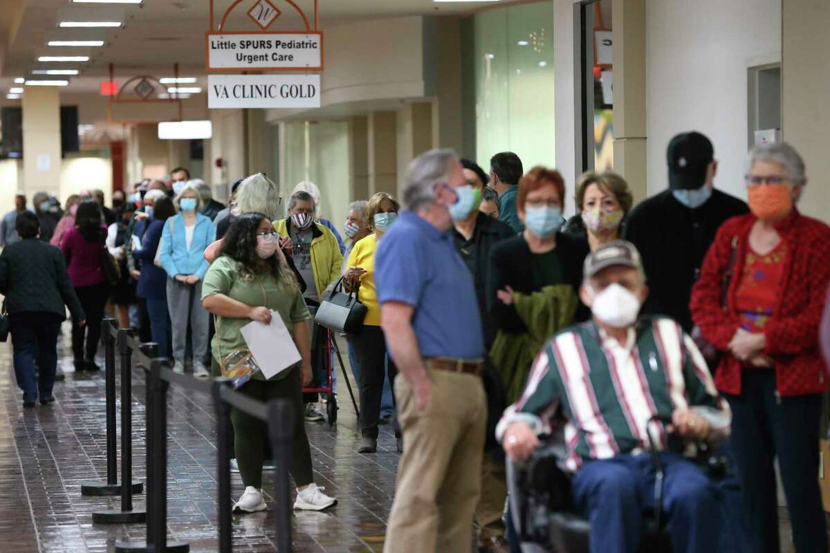 People line up for the Moderna COVID-19 vaccine administered by University Health at Wonderland of Americas Mall, Monday, Jan. 4, 2021. It is the first day of vaccinating people in the 1B group, those 65 years and over and 18 and above with certain medical conditions. The 17,280 vaccination slots were taken up in five hours after University Health opened the website for registration on Dec. 31.