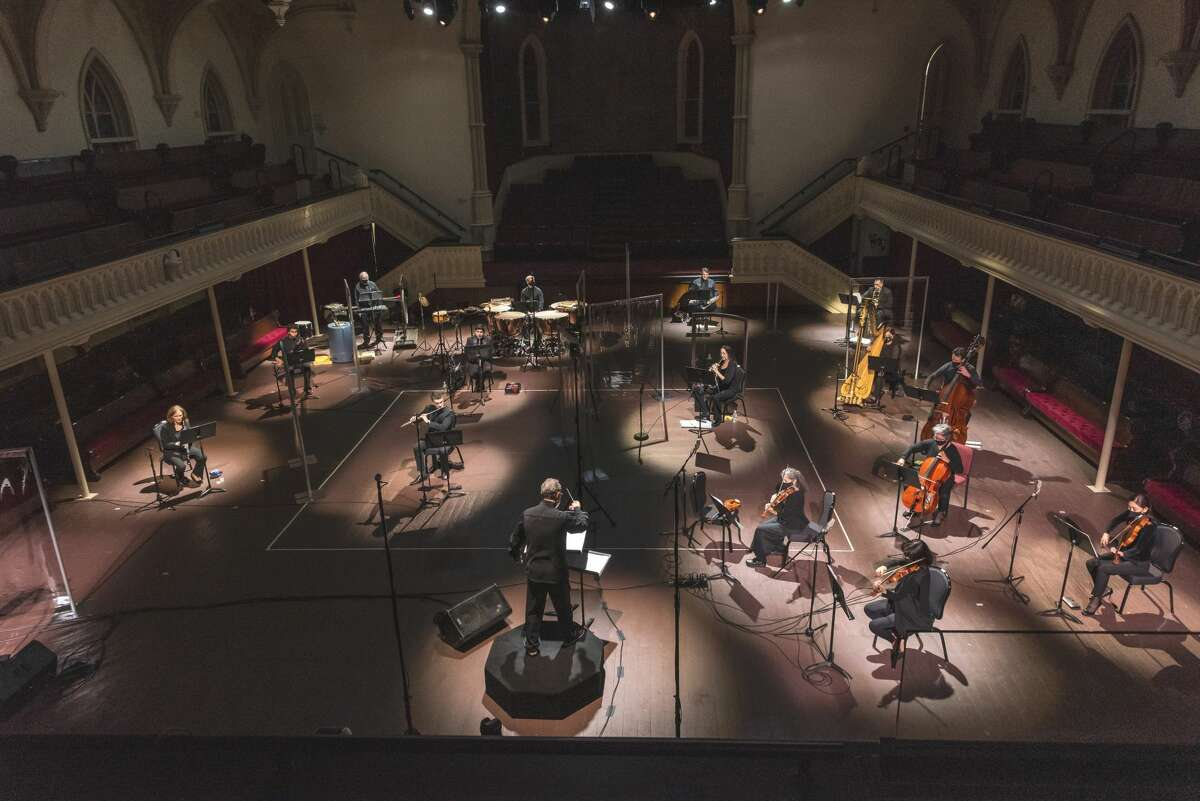 For rehearsals and performances, members of the Albany Symphony Orchestra are spaced widely across the main floor of Universal Preservation Hall in Saratoga Springs. (Gary Gold photo.)