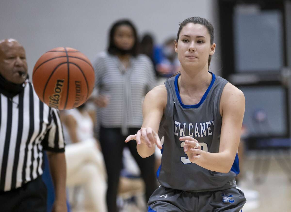 New Caney power forward Tori Garza (32) passes the ball during the third quarter of a non-district girls basketball game at Grand Oaks High School in Spring.