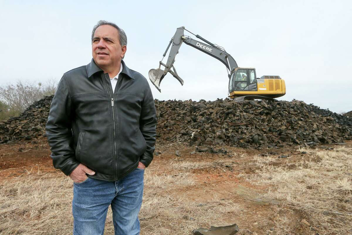 Then-state Rep. Tomas Uresti stands in front of a trackhoe sitting on top of a pile of shredded tires waiting to load them onto a truck for removal in January 2018. Uresti, younger brother of imprisoned former Sen. Carlos Uresti, is planning to run for San Antonio City Council, District 3, in the May elections.