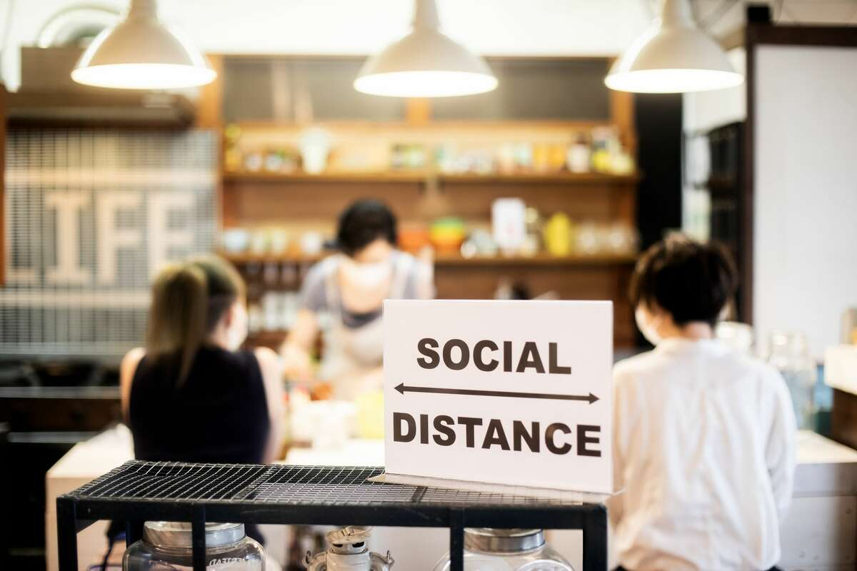 A family has social distancing concerns while eating at a restaurant.