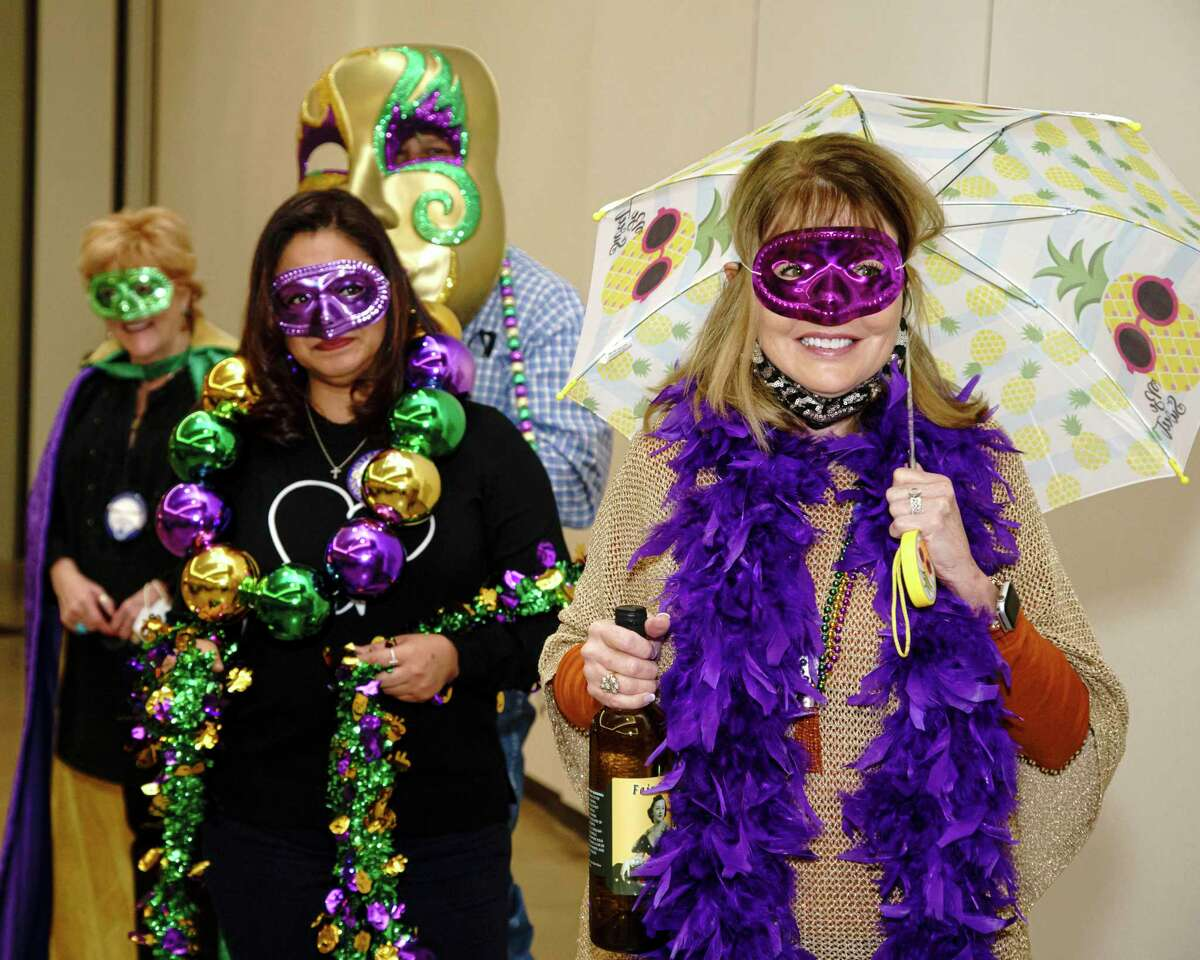 Members of the Conroe Noon Lions Club are preparing for their annual Dinner/Dance & Auction coming up on Feb. 11 and they kicked off announcements with a 'second line' at the club meeting Wednesday. Pictured front to back are Karen Lonon, Lorena Garcia, Scott Perry, Sara Coots.