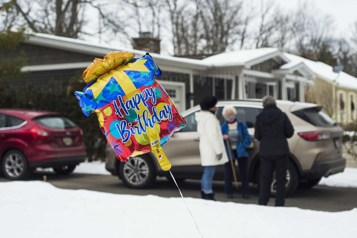Members of the Chemical City Garden Club congregate outside of the home of fellow club member Connie Lesh Friday, Jan. 8, 2021 to wish her a happy 79th birthday. (Katy Kildee/kkildee@mdn.net)