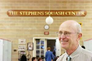 013108--King Street--Greenwich--Brunswick squash coach Jim Stephens stands in the newly named Stephens Squash Center at the school, a gift from the Pedersen family. Keelin Daly/ Staff Photo Boys squash: Sign catches Stephens by surprise. Squash Center named in Bruins coach's honor