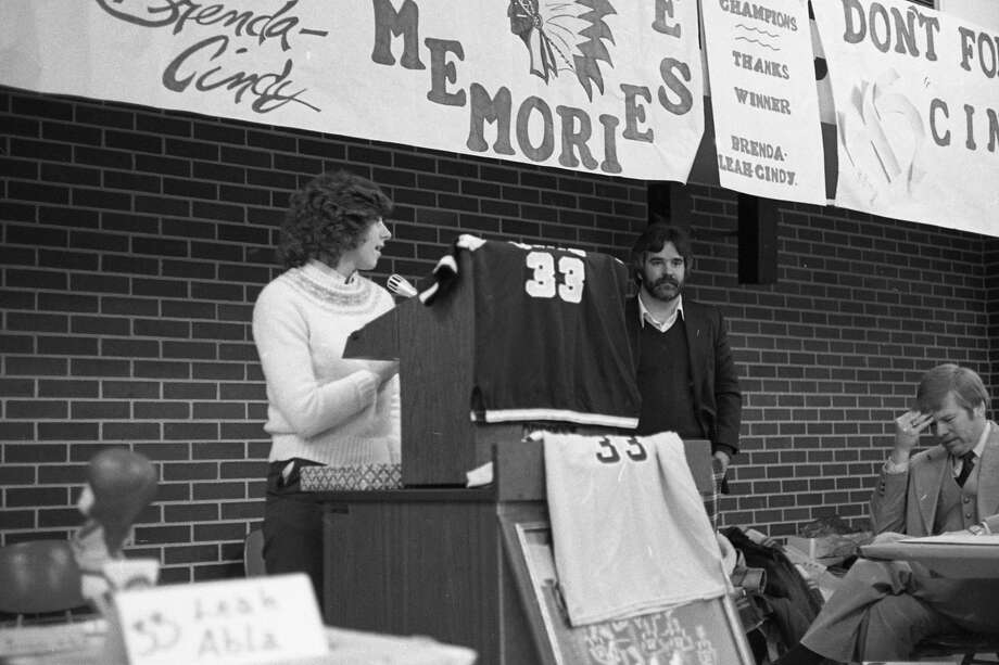 On this day in 1981, the front page of the News Advocate highlighted Leah Abla, a three-time All-State guard for the Manistee High School girls varsity basketball team, who was honored at an awards ceremony. Abla's No. 33 was officially retired at the ceremony. Pictured are Abla, Coach Mike Munro and Coach Jim Anderson. Photo: Manistee County Historical Museum Photo