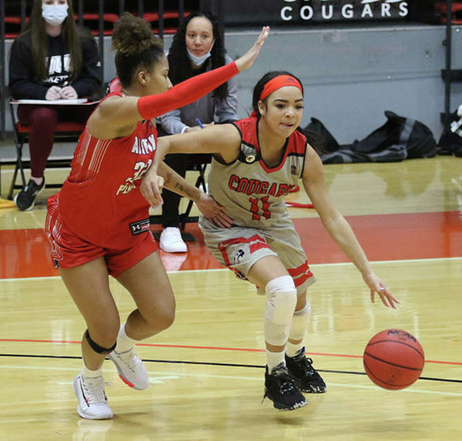 SIUE's Mikia Keith (right) handles the ball against pressure from Austin Peay's Brianah Ferby on Thursday afternoon at First Community Arena in Edwardsville. Photo: Greg Shashack   Hearst Illinois