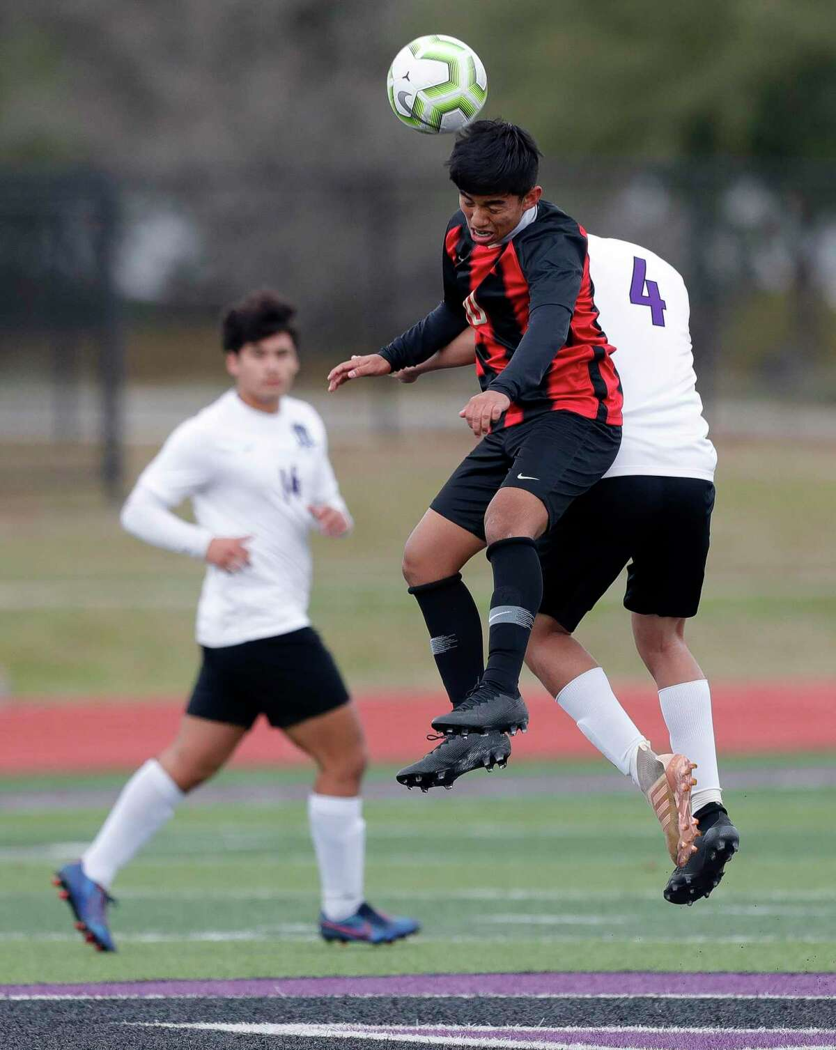 Porter's Jovany Garcia (10) heads the ball against Willis' Byron Rocha (4) in the first period of a match during the Wildkat Showcase soccer tournament at Berton A. Yates Stadium, Friday, Jan. 8, 2021, in Willis.