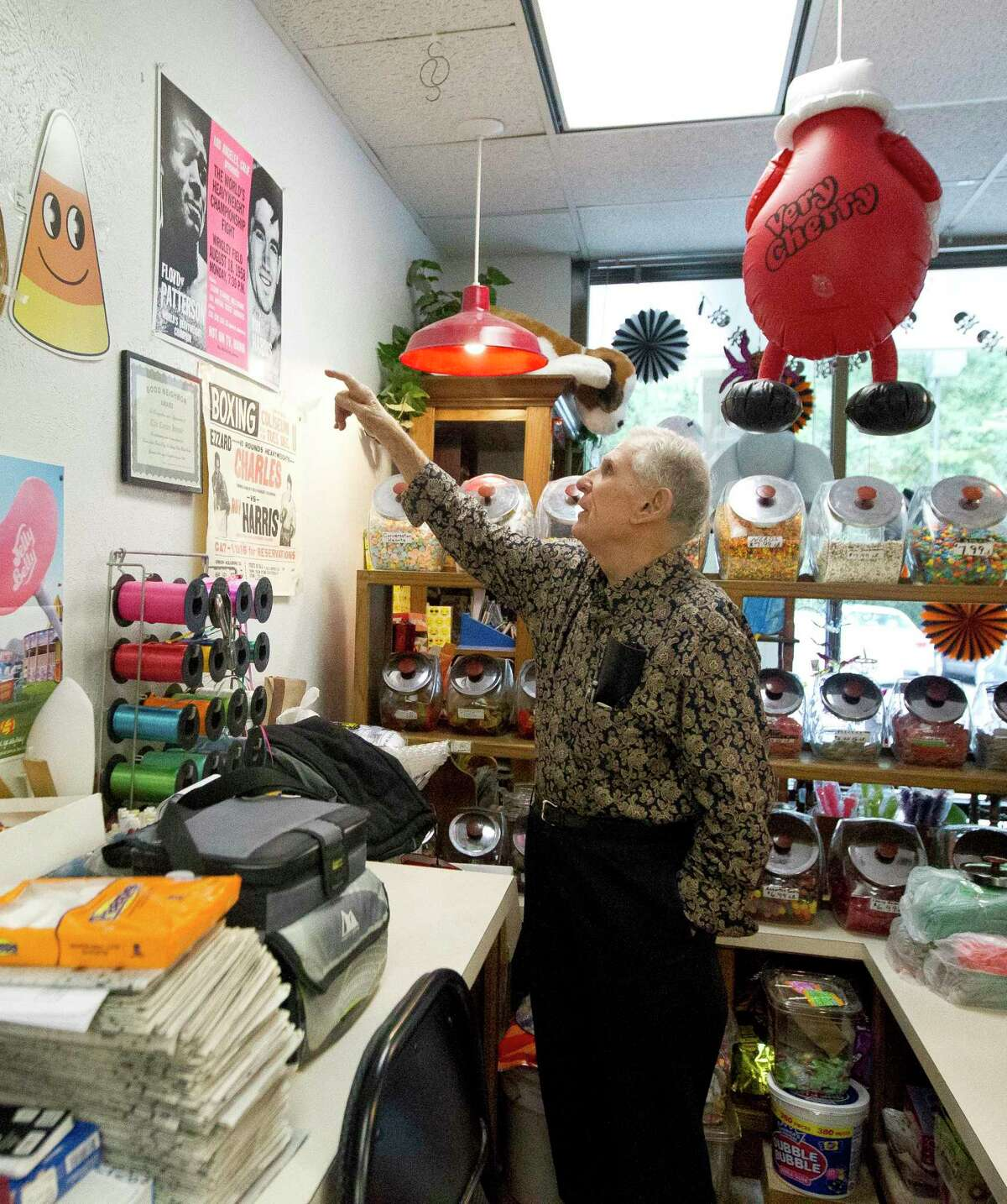 Donald Baker, 88, points out autographed posters of retired heavyweight boxer Roy Harris that hang in The Candy House on Glen Loch Drive, Wednesday, Oct. 30, 2019, in Spring. The Cut and Shoot resident and his family have occasionally visited the store Baker and his wife have owned for more than 20 years. Baker died Jan. 2 at age 89.