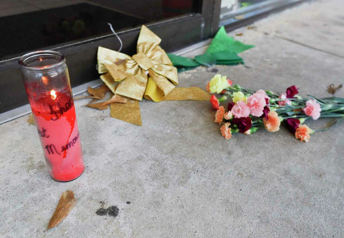 A small memorial is seen outside The Candy House after owner Donald Baker Sr., 89, died of complications from COVID-19, Tuesday, Jan. 5, 2021, in Spring.