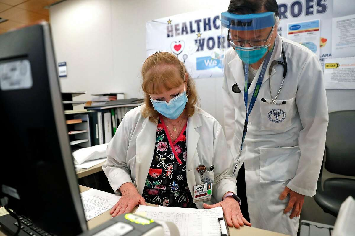 Santa Clara Valley Medical Center ICU nurse Suzie Minnich and Dept. of Medicine Chair Dr. Cliff Wang at the hospital in San Jose, Calif., on Thursday, January 7, 2021.