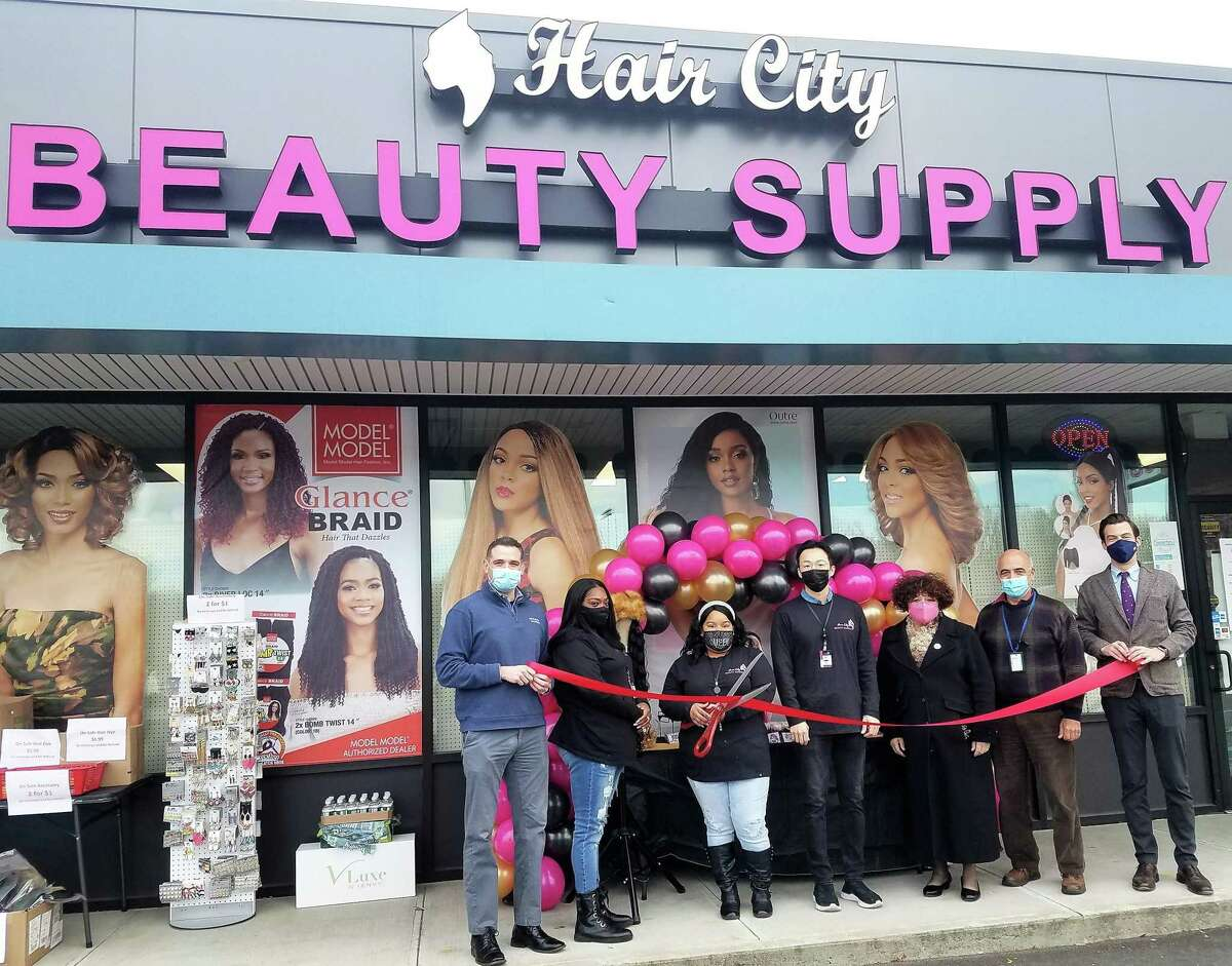 Hair City Beauty Supply, 533 Washington St., held a grand opening Nov. 19, 2020. From left, Middlesex County Chamber of Commerce Vice President Jeffrey Pugliese, wig manager Katria Askew, general manager ShaRhonda Cherry, owner Ken Jiyong Song, Chamber Central Business Bureau Chairwoman Pamela Steele, Middletown Economic Development Specialist Thomas Marano, and Mayor Ben Florsheim were in attendance.