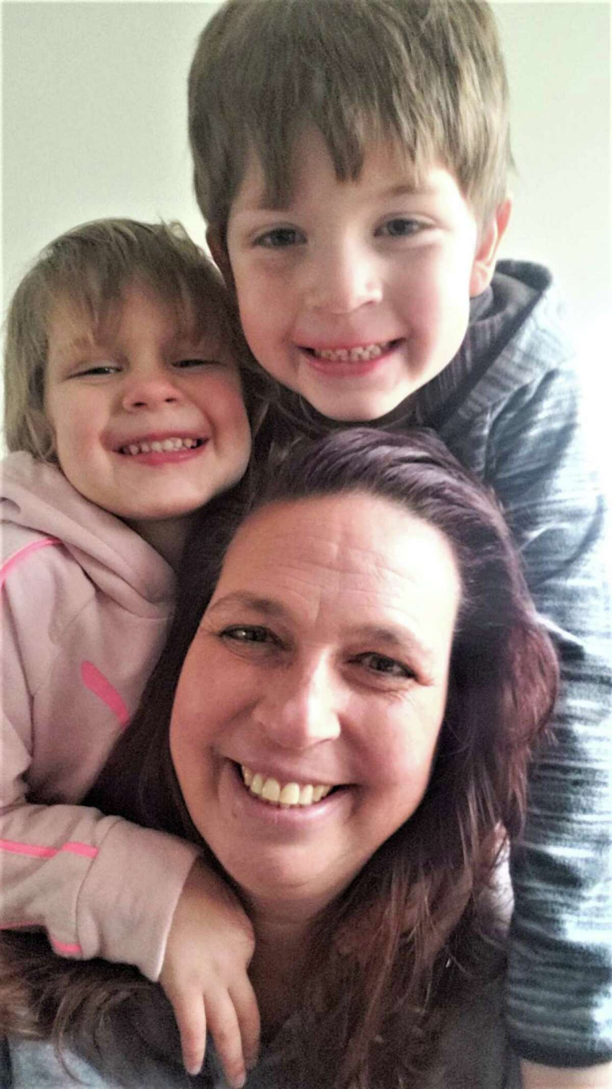 Melysa D'Amato of Portland, a phlebotomist at Midstate Medical Center in Meriden, discovered she had a brain tumor on her optic nerve after a car accident in November. Her co-worker has set up a GoFundMe drive with a $10,000 goal to help D'Amato with living expenses. She is shown with her children Taygan, 3, at left, and Brayden, 5, at top.