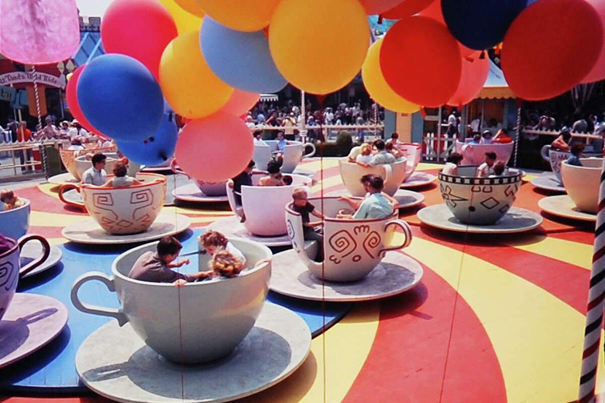 People sitting in the cups at Disneyland Park, Anaheim, Calif., 1962.