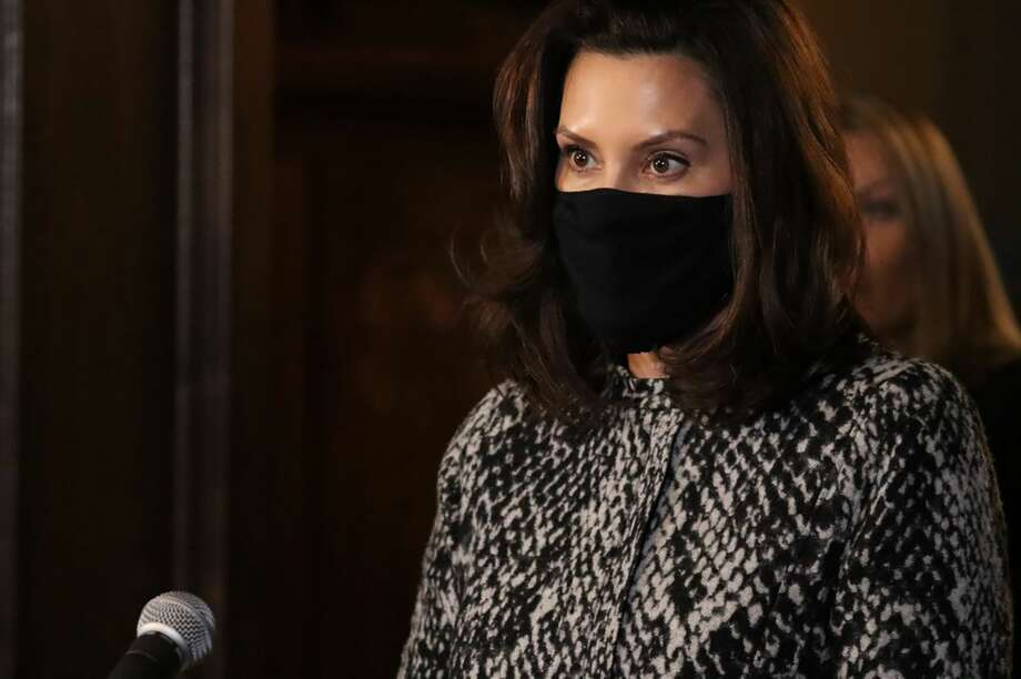In a photo provided by the Michigan Office of the Governor, Gov. Gretchen Whitmer addresses the state in Lansing, Mich., Friday, Jan. 8, 2021. Whitmer strongly encouraged all K-12 schools in Michigan to offer in-person instruction by March 1, stopping short of requiring it but saying face-to-face classes should at least be an option. Photo: Michigan Office Of The Governor Via AP