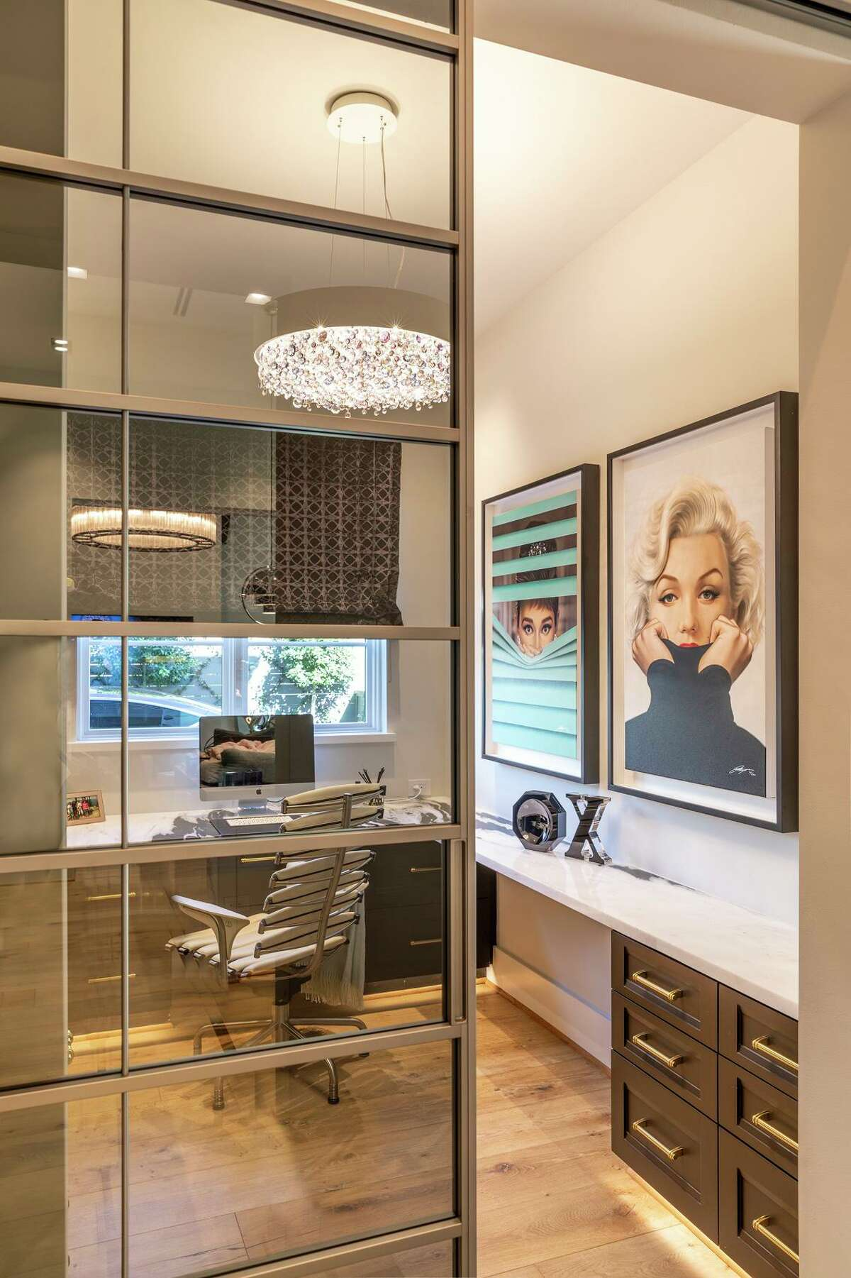 April Palafox has her own office, with Audrey Hepburn and Marilyn Monroe portraits by artist Michael Moebius.