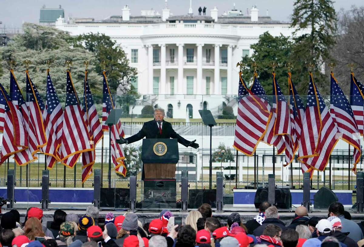 With the White House in the background, President Donald Trump fires up the crowd at a rally before they stormed the Capitol to halt a free and fair election that didn't go their way.