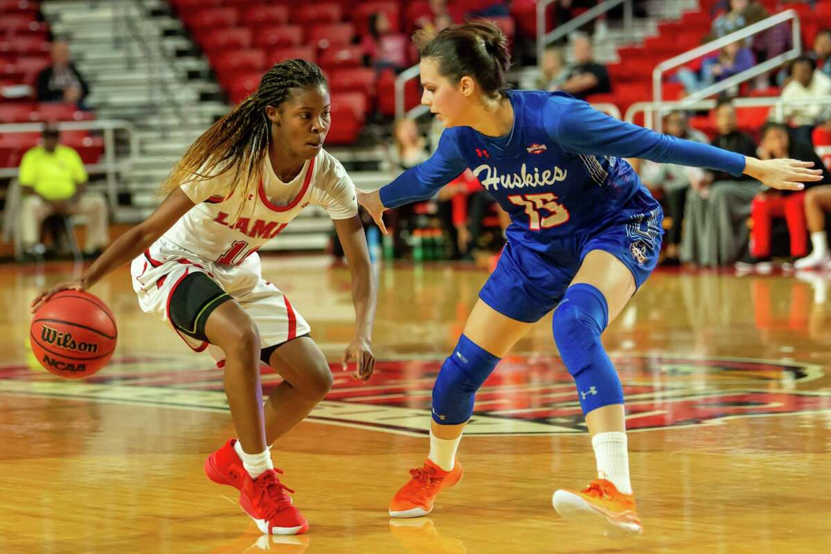 Malay McQueen (10) works the ball around Julija Vujakovic (15) in the first half as he Lady Cardinals took on the Huskies of Houston Baptist at the Montagne Center on Saturday, January 11, 2020. Fran Ruchalski/The Enterprise