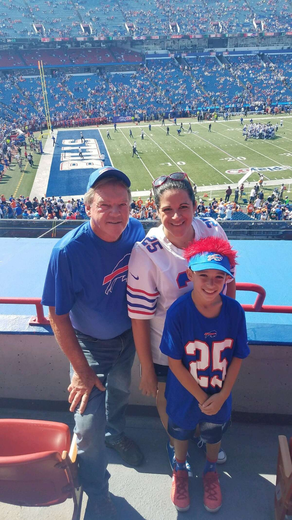 Bills fan Erin Villenueve, center, with her father John Graham, left, and son Anthony Ragazzo.