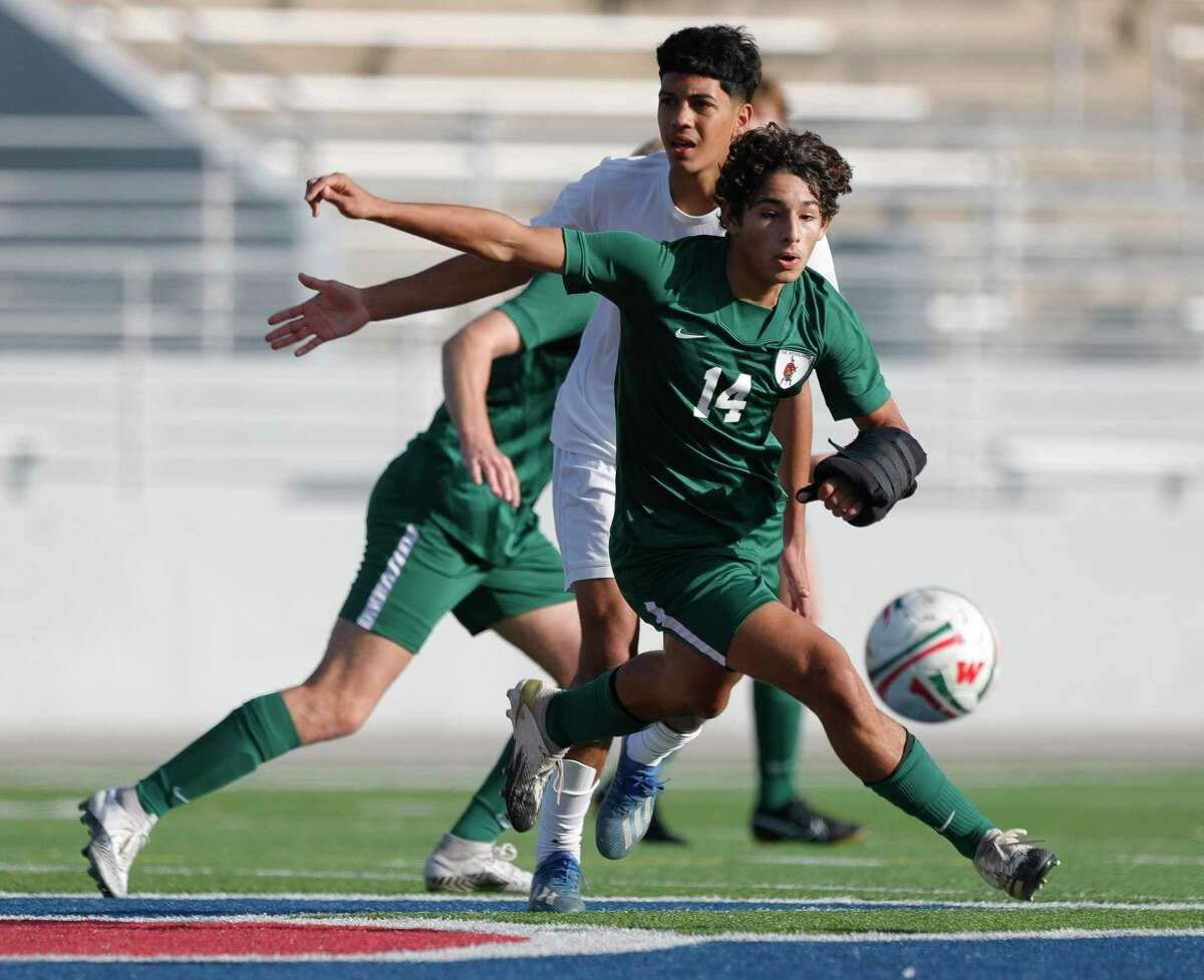 The Woodlands midfielder Tomas Cabrales (14) looks to control the ball during the first period of a match during the Kilt Cup soccer tournament, Friday, Jan. 8, 2021, in Shenandoah.
