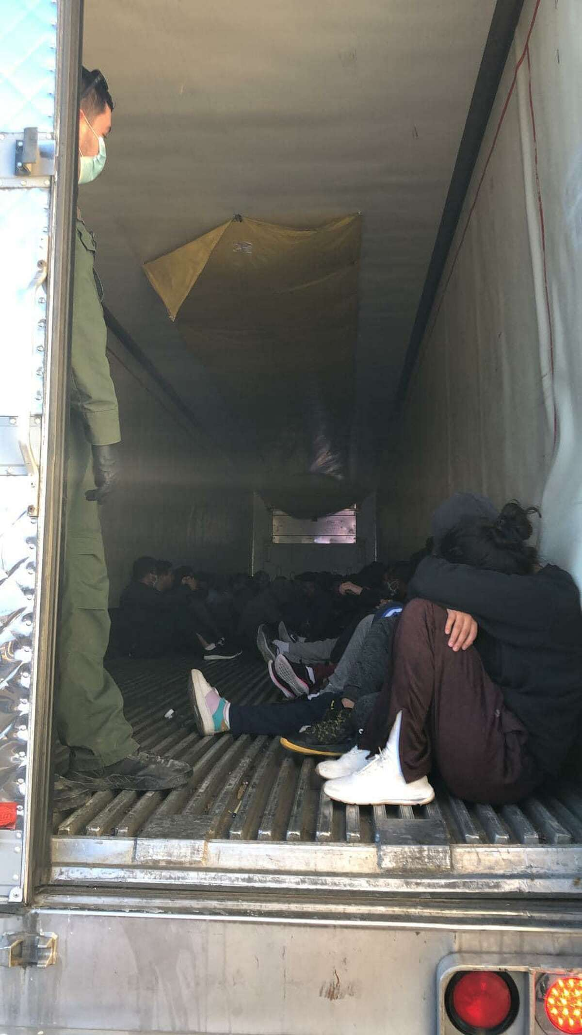 Laredo police officers and U.S. Border Patrol agents discovered 52 people inside a trailer. All were determined to be immigrants who were in the country illegally.