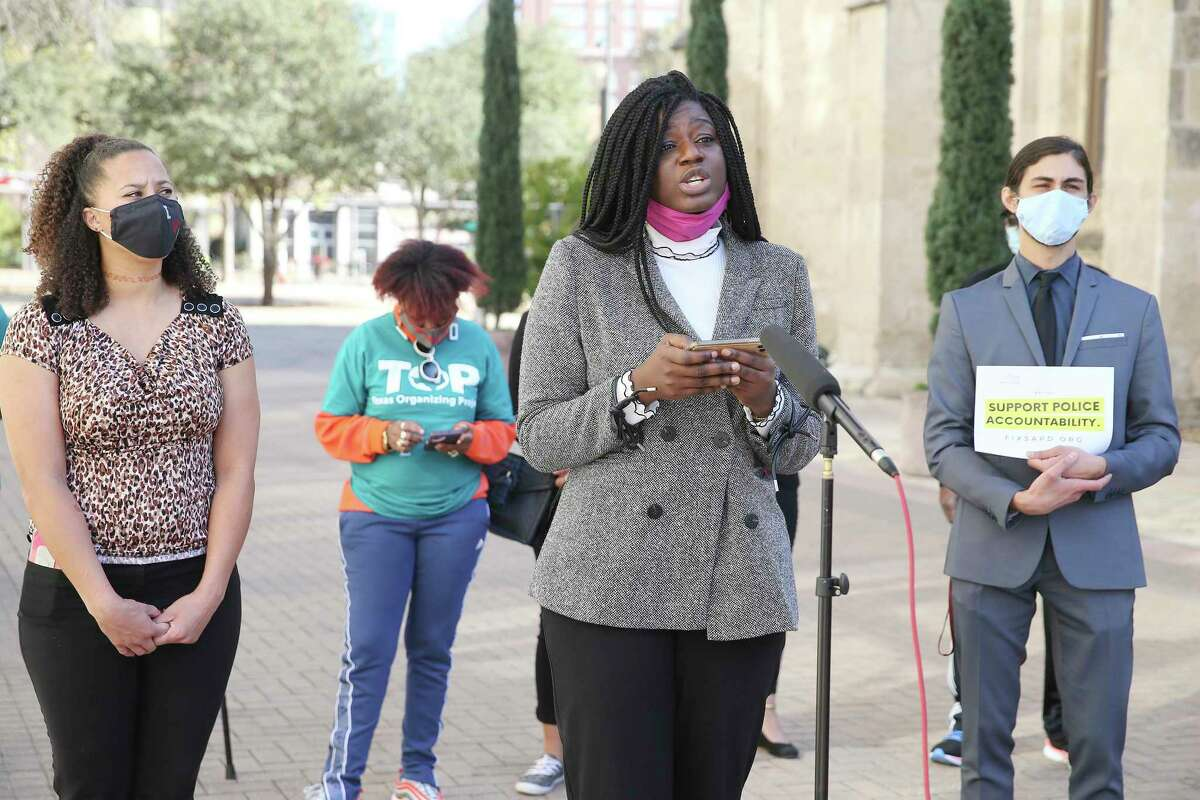 Co-founder Ojiyoma Martin (center) of Fix SAPD addresses the media after the organization submitted roughly 20,000 signatures to the City Clerk's Office for validation.