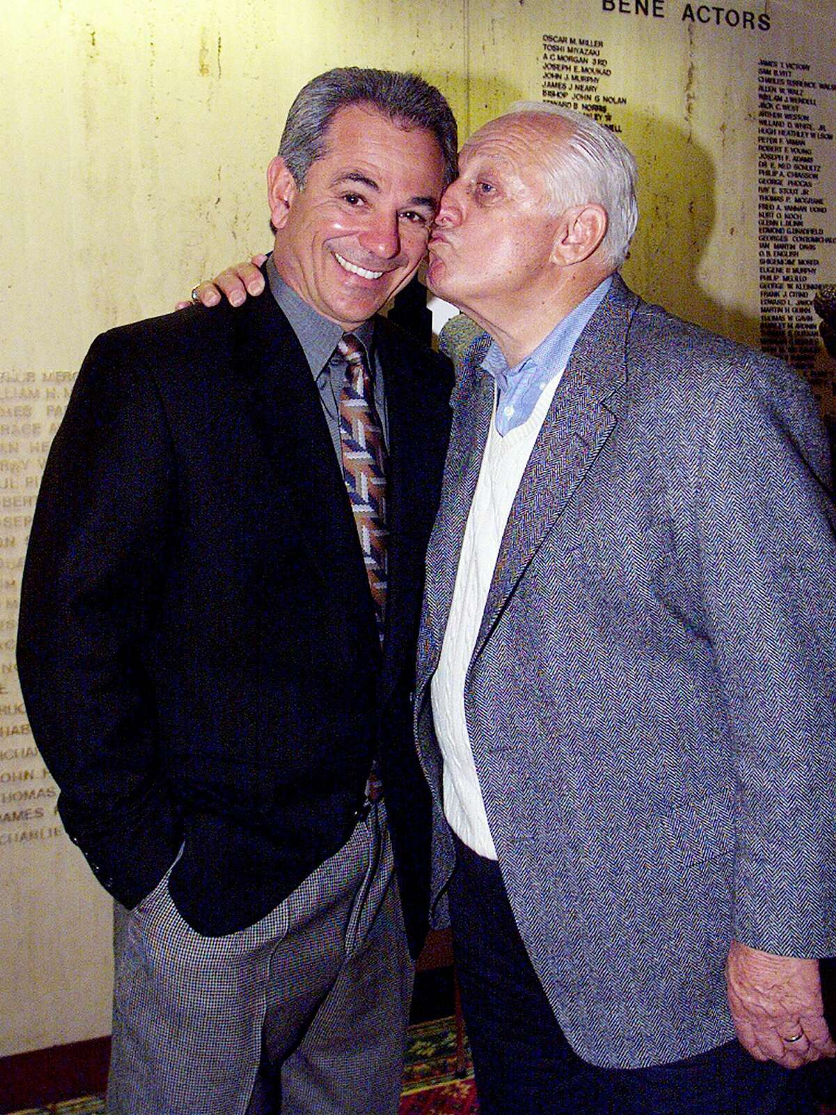 Mets' manager Bobby Valentine gets a kiss from Dodgers' vice president Tommy Lasorda at the New York Athletic Club, where Valentine was honored as the club's manager of the year.