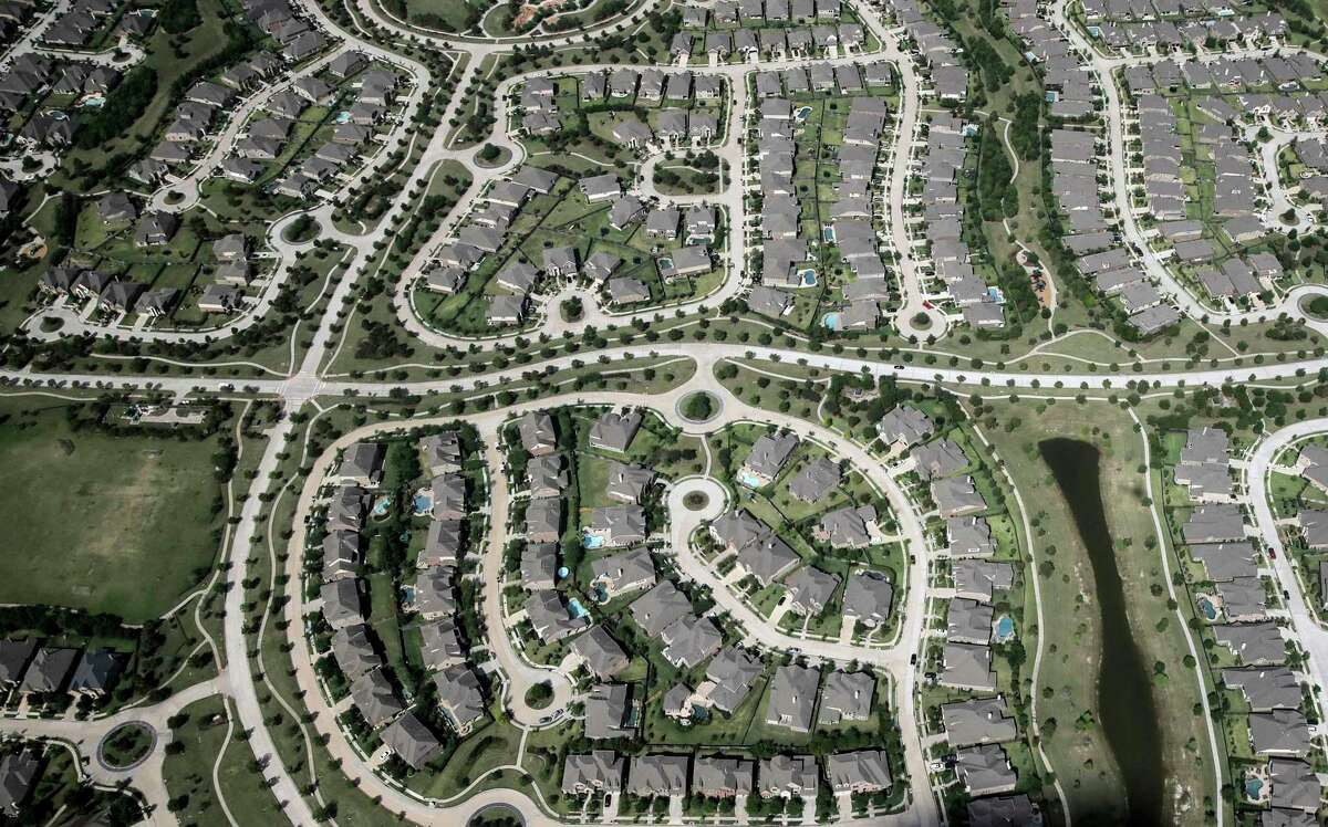 A suburb located northwest of Houston as seen from Co-Star's aerial research team plane in Katy. Recordings by the real estate brokerage REX show Houston real estate agents declining to show their clients homes that would require them to negotiate their own commission. ( Elizabeth Conley / Houston Chronicle )