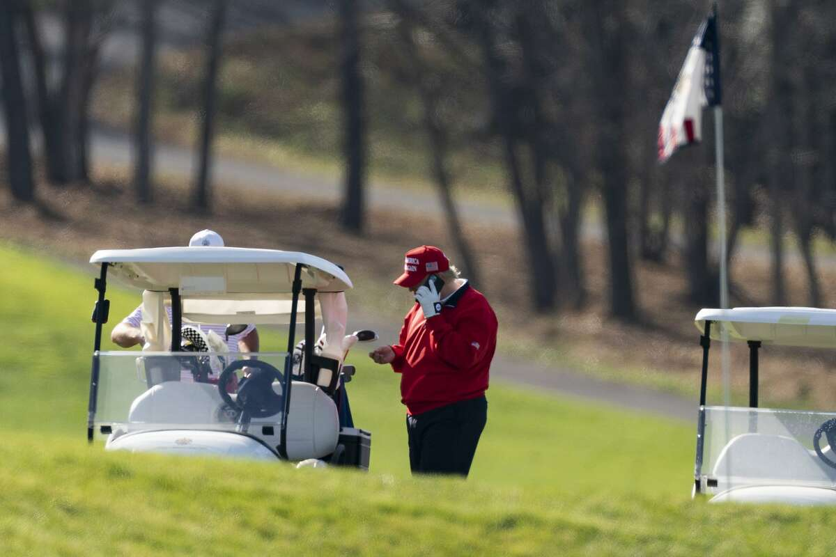 President Trump plays golf at the Trump National Golf Club in Sterling, Va., on Thanksgiving.