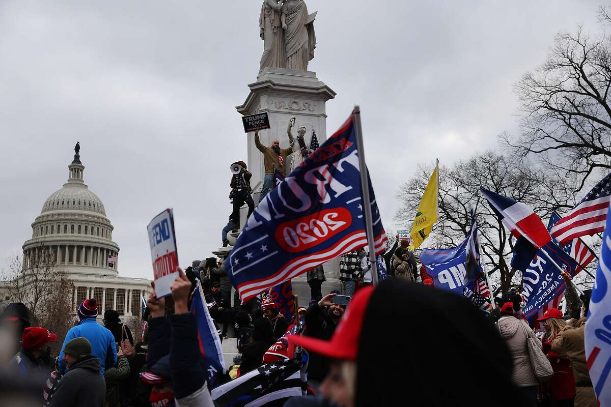 """WASHINGTON, DC - JANUARY 06: Trump supporters gather outside the U.S. Capitol building following a """"Stop the Steal"""" rally on January 06, 2021 in Washington, DC. A pro-Trump mob stormed the Capitol earlier, breaking windows and clashing with police officers. Trump supporters gathered in the nation's capital to protest the ratification of President-elect Joe Biden's Electoral College victory over President Donald Trump in the 2020 election. (Photo by Spencer Platt/Getty Images)"""