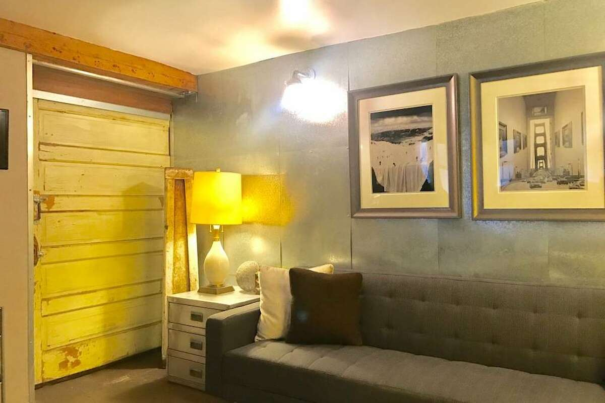 """The apartment is on the ground floor of a 1926 Edwardian building, the listing says, and claims it's """"kinda a man cave,"""" whatever that means."""