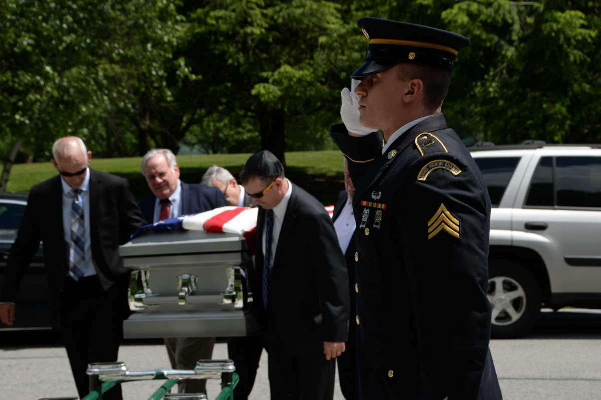 New York Army  National Guard Sgt. Joshua Sanzo a member of the northern district Honor Guard, salutes the casket of Victor Frager during a military funeral in 2018 at the Gerald B. Solomon National Cemetery, Schuylerville.