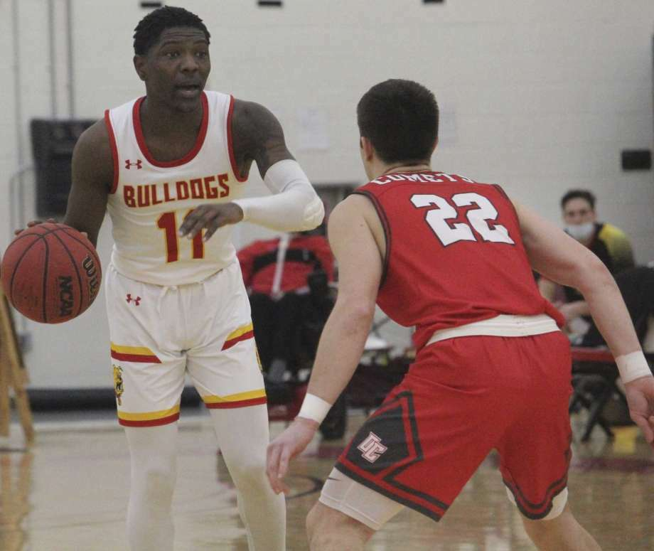 Ferris' Jeremiah Washington looks to make a move against Olivet during a recent game. Photo: (Pioneer File Photo