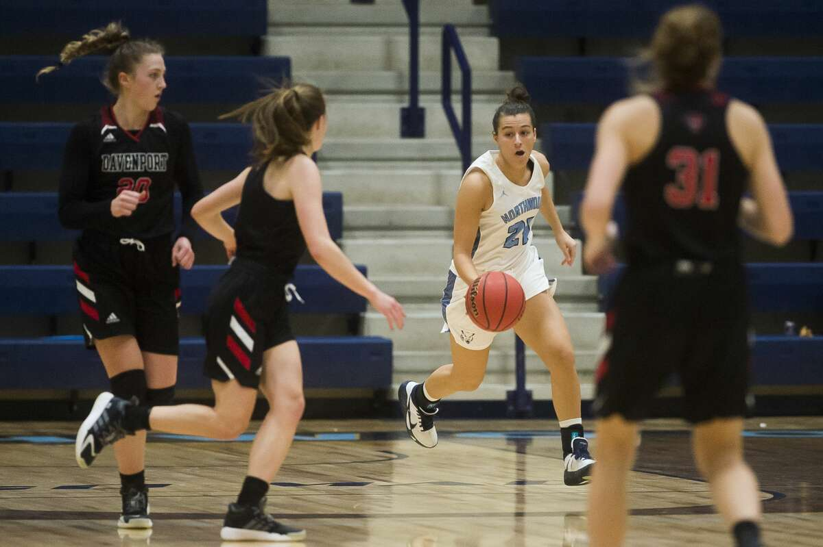 Northwood's Maizie Taylor dribbles down the court during a game against Davenport Friday, Jan. 8, 2021 at Northwood University. (Katy Kildee/kkildee@mdn.net)