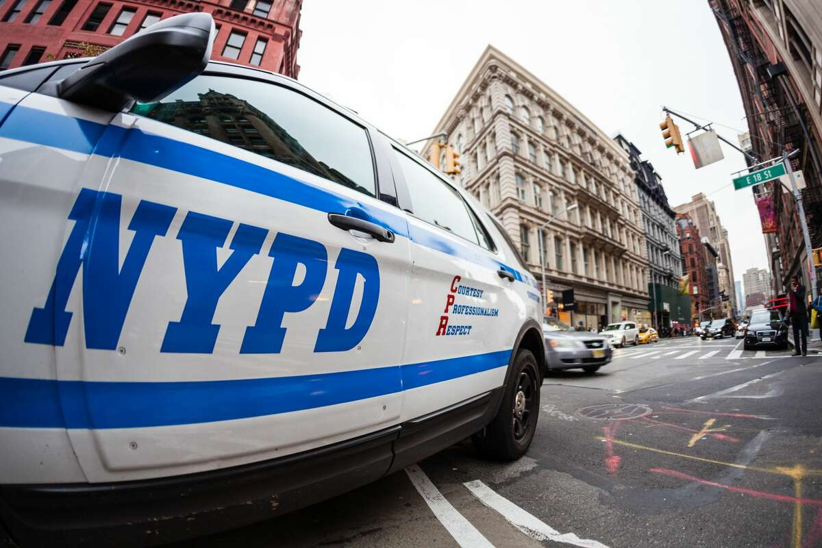 Close up of the NYPD logo on a police car.