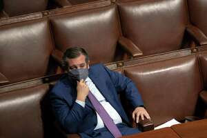 Senator Ted Cruz, a Republican from Texas, listens during a joint session of Congress to count the Electoral College votes of the 2020 presidential election in the House Chamber in Washington, D.C., U.S., on Thursday, Jan. 7, 2021. The U.S. Capitol was placed under lockdown and Vice President Mike Pence left the floor of Congress as hundreds of protesters swarmed past barricades surrounding the building where lawmakers were debating Joe Biden's victory in the Electoral College. Photographer: Stefani Reynolds/Bloomberg