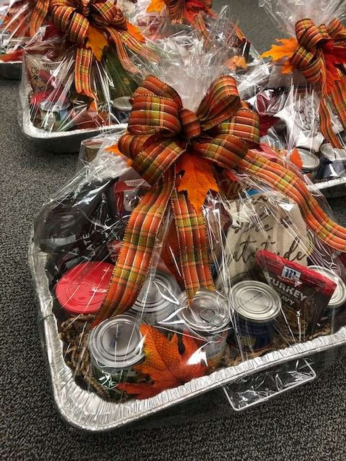 Realtors from Pearce Real Estate made and donated Thanksgiving holiday baskets for those in need within their communities. The 25