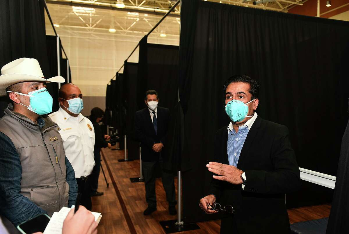 Texas Division of Emergency Management 's Gerardo Castillo and Dr. Rashid Chotani answer questions for the media, Friday, Jan. 8, 2021, during a media walk-through of an infusion center for mild COVID-19 cases at the Haynes Recreation Center.