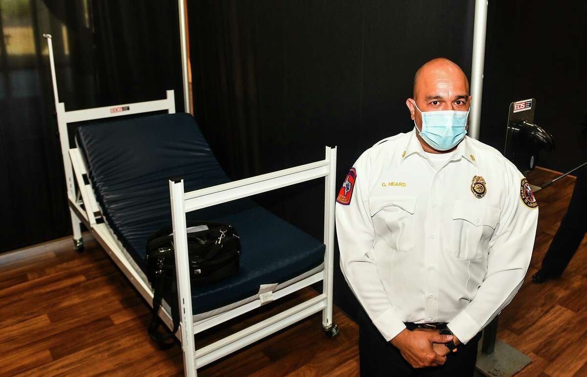 Laredo Fire Chief Guillermo Heard stands next to one of the beds at the infusion center for mild COVID-19 cases on Jan. 8 at the Haynes Recreation Center during a media walkthrough.