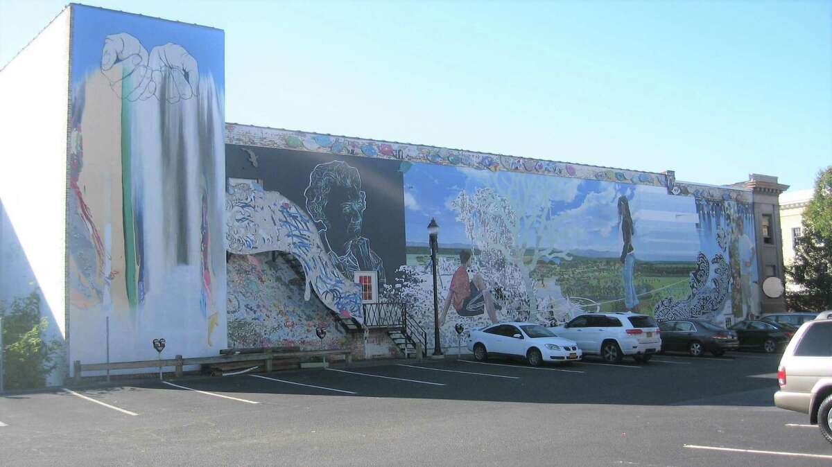 A mural that was created on the wall of the former Libby building in Torrington was removed after the building was sold and redeveloped. The parking lot shown above could be home to a new mural, based on plans formed by the city's Cultural Affairs Committee. The mural would be on the pavement, not the building.