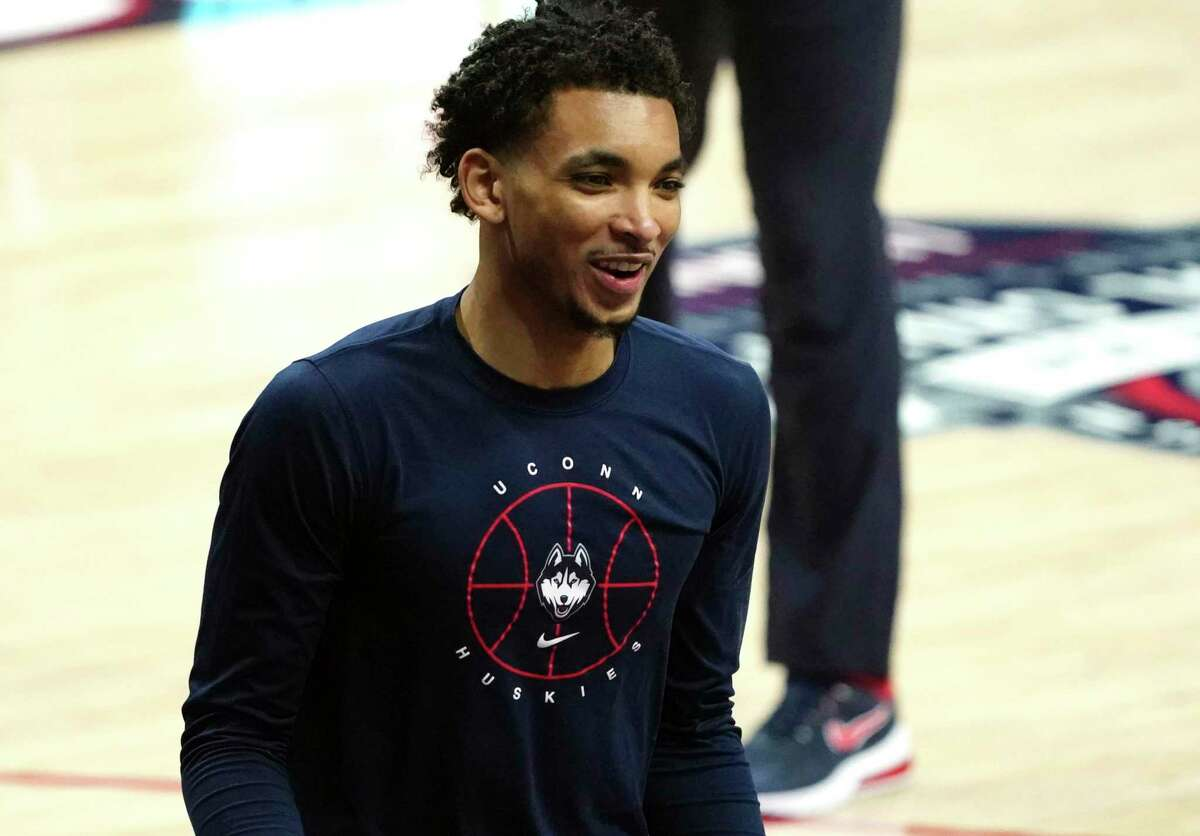 Connecticut Huskies guard James Bouknight (2) warms up before a game against the DePaul Blue Demons at Harry A. Gampel Pavilion in Storrs, Conn. (David Butler II/Pool Photo via AP)