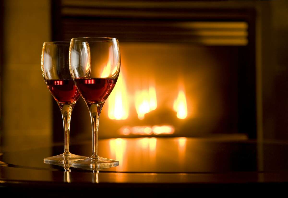 Wine glasses and fireplace.