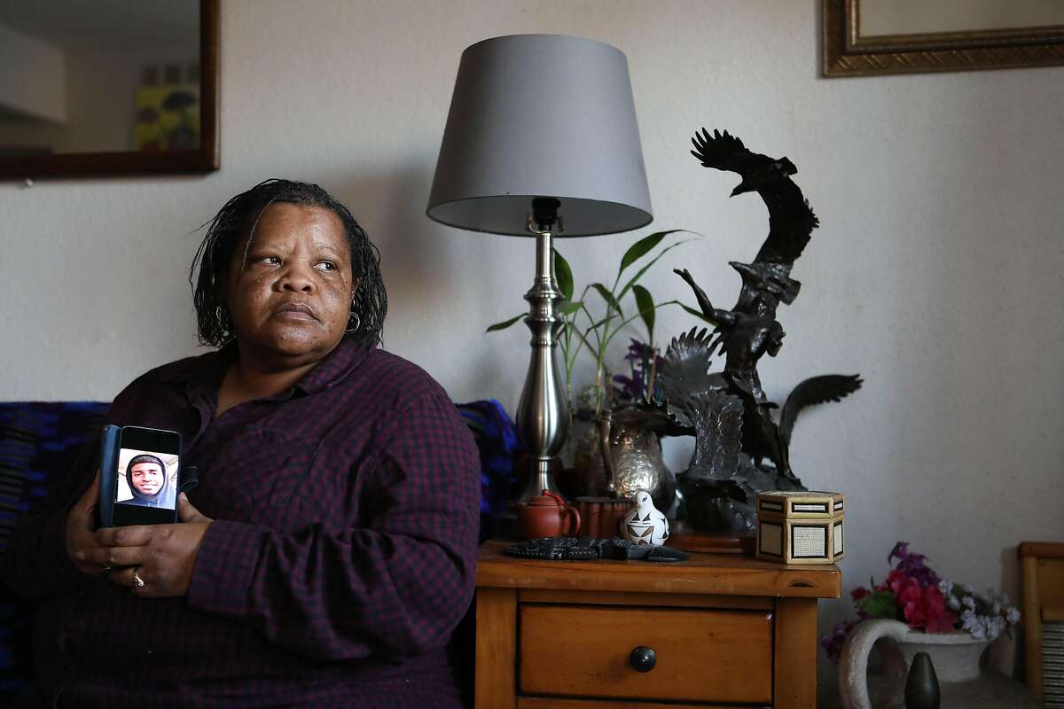 """Renita Joseph of Oakland holds a portrait of her late godson, Jaleel Harris, 17, who was gunned down on Sept. 28. Joseph was also his legal guardian. """"I embraced him with all the love I could,"""" Joseph said. """"I didn't want him to be a statistic and that's exactly what happened."""""""
